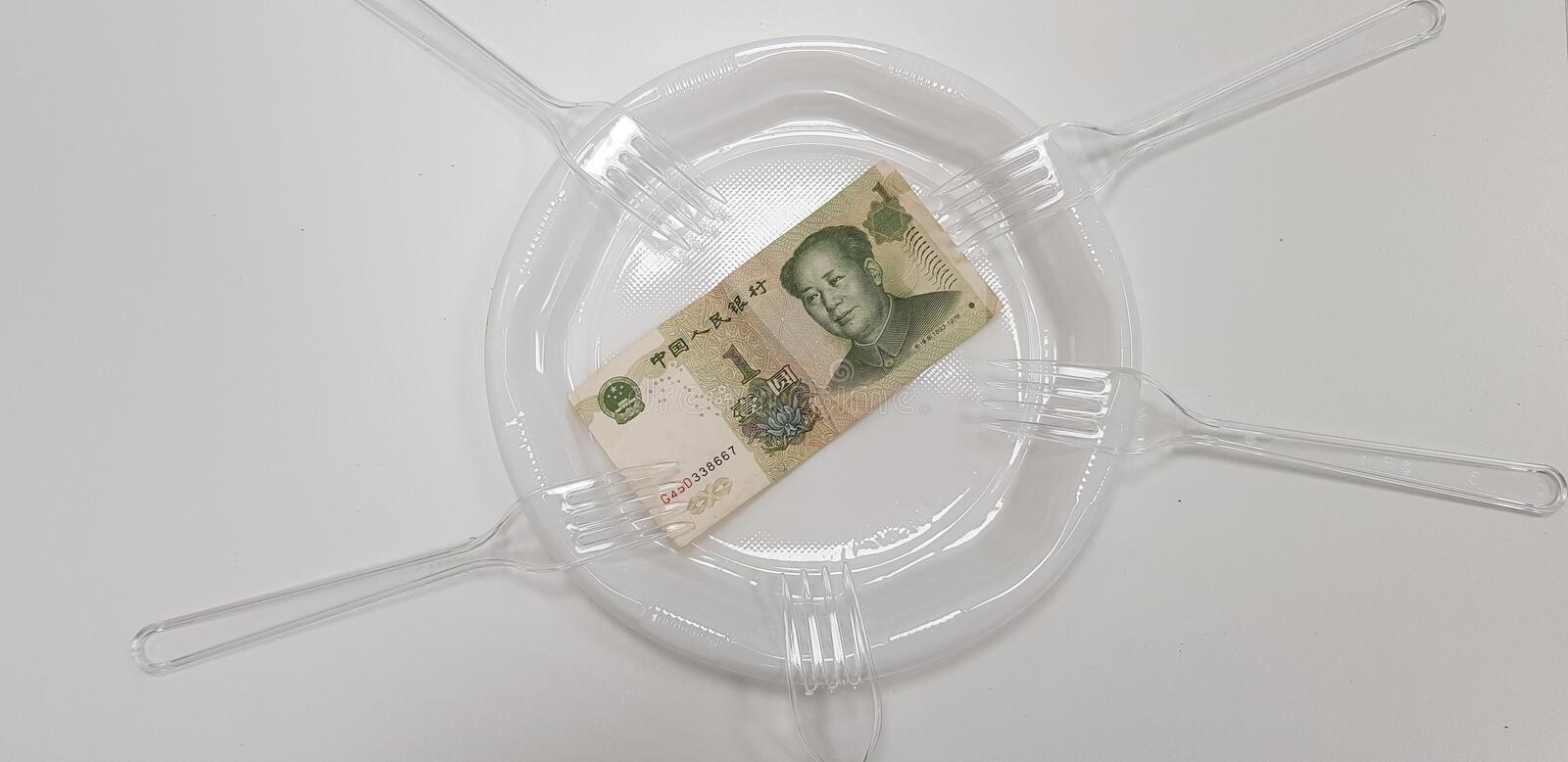 One china money banknote on empty white plastic plate. Surrounded by five disposable transparent forks asia bookmaker brokerage budget business capital currency royalty free stock photos