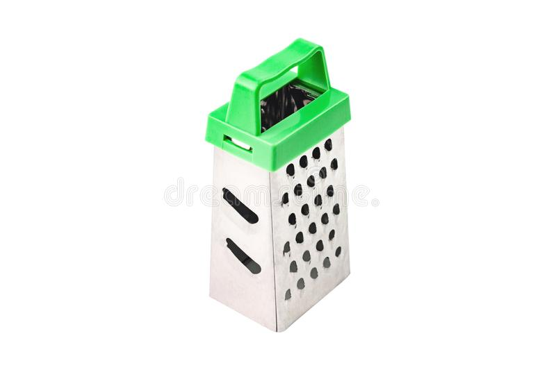 One clean glossy metal sharp grater with green plastic handle for different products for cooking isolated on white stock images