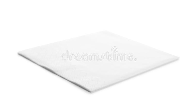 One clean paper napkin. On white background royalty free stock image