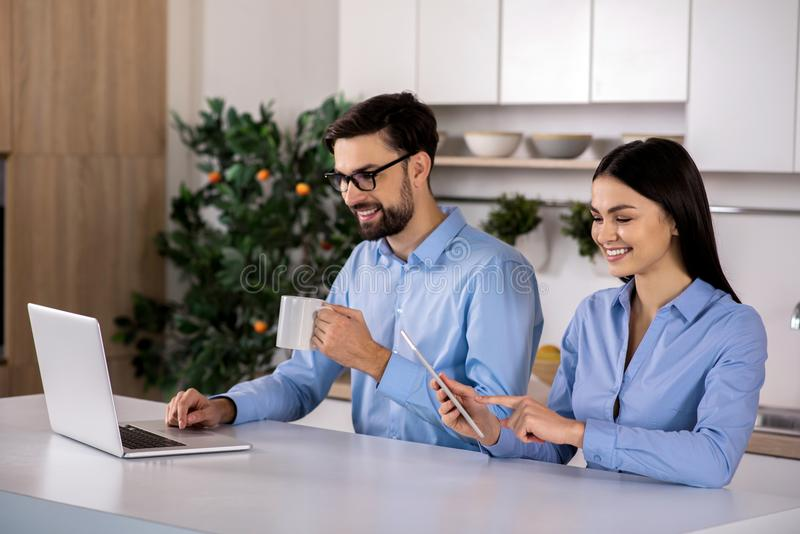 Positive business colleagues sitting at the table royalty free stock photo