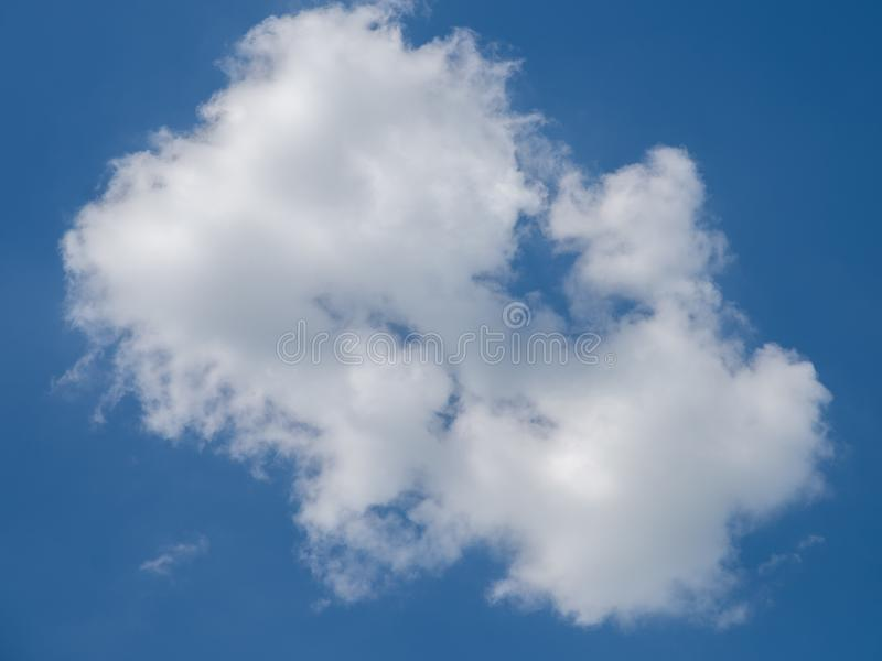 One cloud on the blue sky stock photography