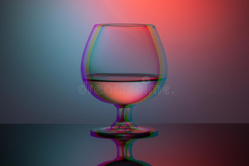 One cognac glass on the table duotone and glitch effect.  stock photos
