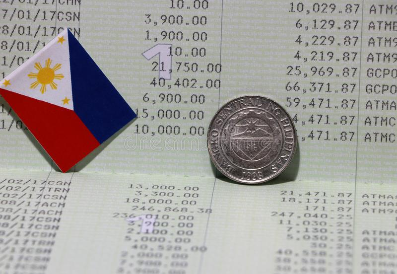 One coin of Philippine peso money on reverse and mini Philippine flag on the book bank. Concept of Saving money. Or finance stock images