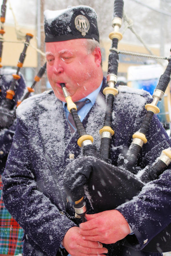 One Cold Piper. Piper at the early St. Patrick's Day Parade in Bethpage, Long Island, New York royalty free stock photos