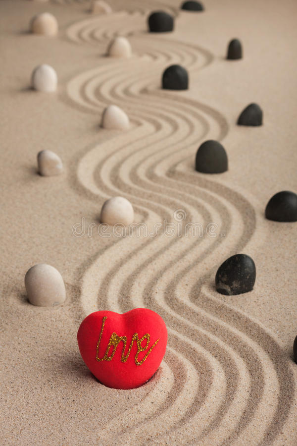 One conceptual heart in the sand stock photo