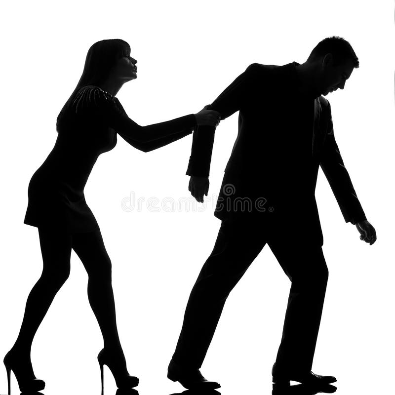One couple dispute separation man leaving and woman holding back royalty free stock image