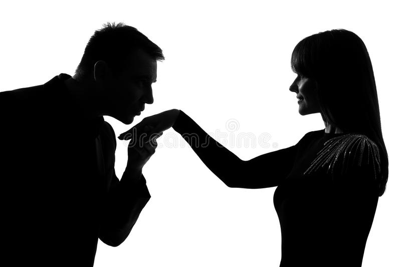One couple man kissing hand woman. One caucasian men kissing hand women in studio silhouette isolated on white background stock images