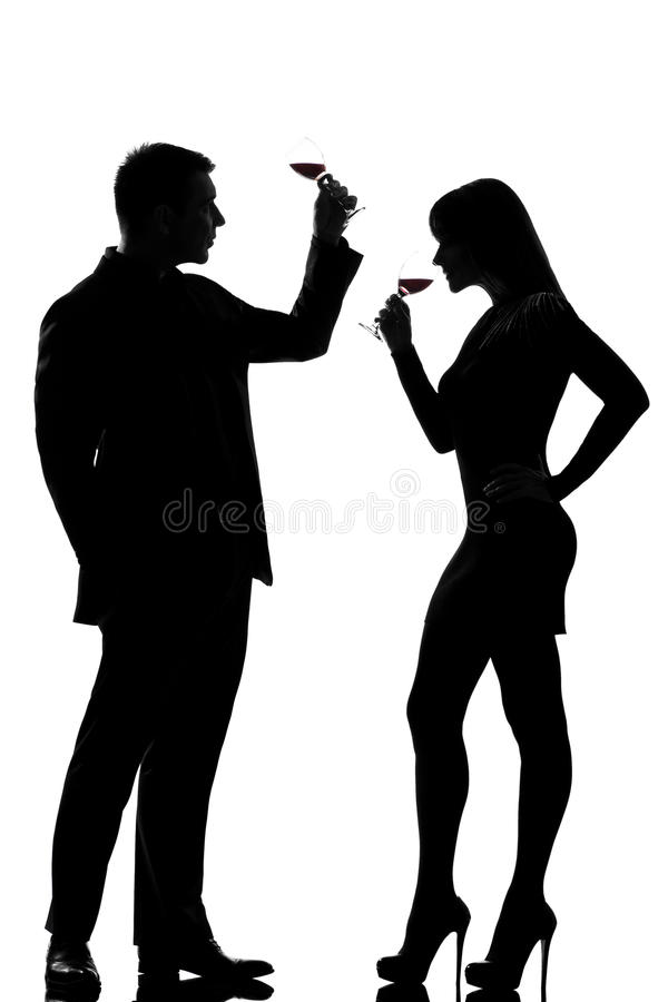 One couple man and woman drinking tasting red wine royalty free stock photography