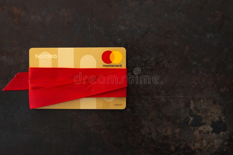 One credit card Mastercard wrapped in red ribbon as a gift royalty free stock images