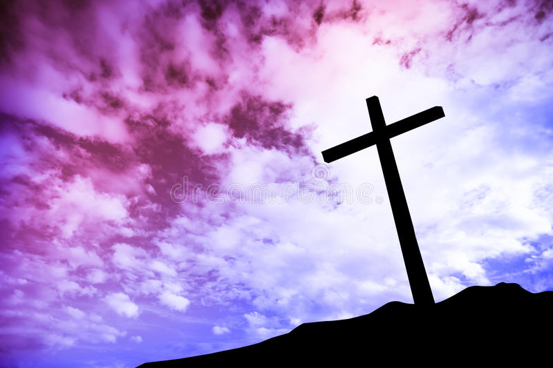 One cross on a hill stock photography