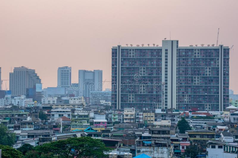 One of the crowded buildings in residence area of Bangkok metropolitan in the evening royalty free stock photography