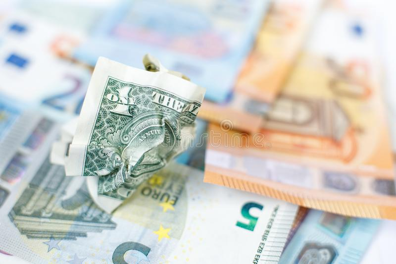 One crumpled US dollar is on new euro banknotes. The concept is new and old. Waiver of cash. Currency exchange. Money is paper. royalty free stock photo
