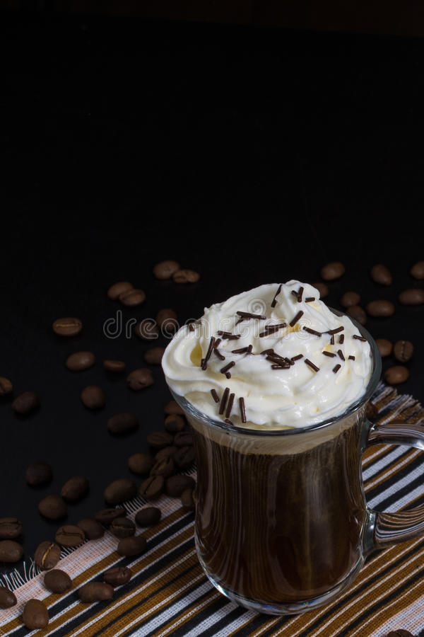One cup of coffee with whipped cream and chocolate decoration royalty free stock photography
