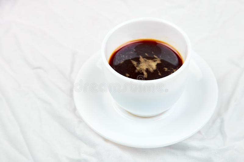 One Cup of coffee on white bed. Concept good morning. Lifestyle. Relax. Vacation. Copy space. Top view royalty free stock photos