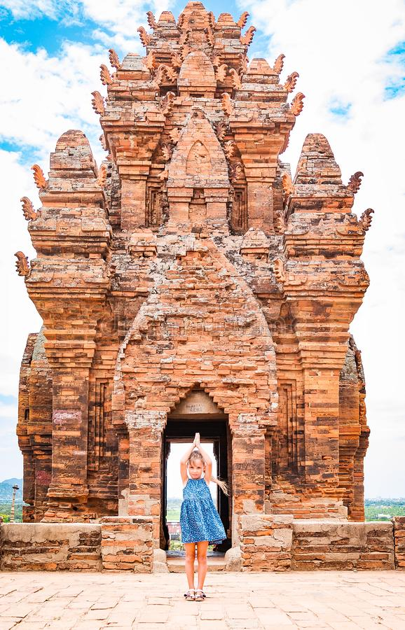 One dancing little girl on Poklongarai champa tower. Yoga position. Located in Phan Rang city, to the south of Nha Trang stock photos