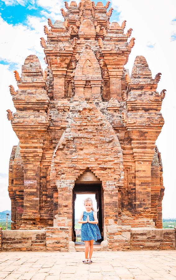 One dancing little girl on Poklongarai champa tower. Yoga position. Located in Phan Rang city, to the south of Nha Trang royalty free stock photography
