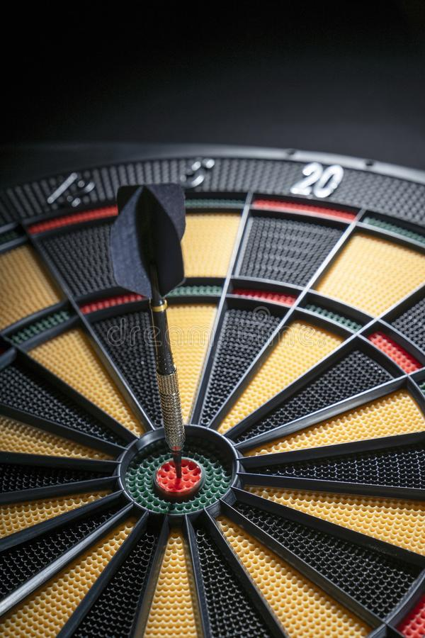 One dart in bullseye of dartboard stock photography