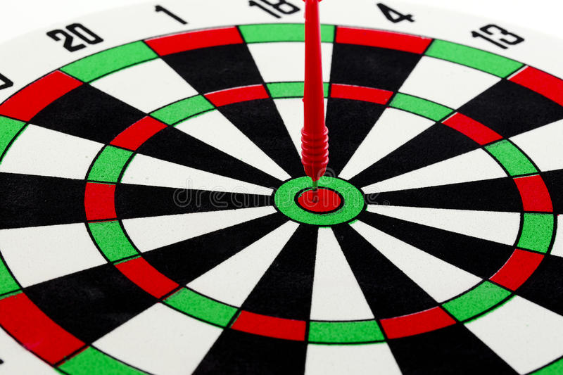 One darts in center of target isolated on white stock photos