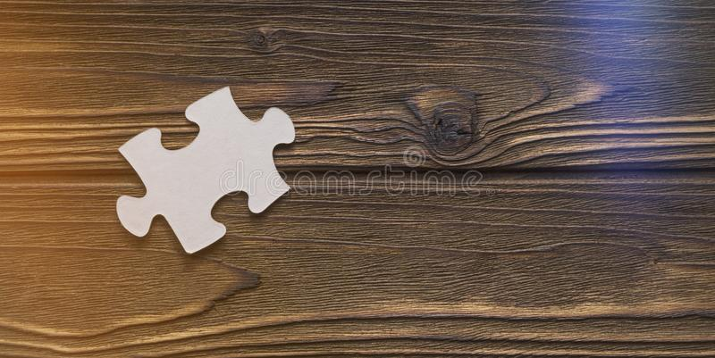 One detail of a puzzle on a tree texture, missing detail. stock images