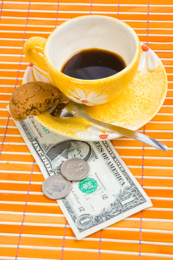 One dollar and 50 cent pay for coffee and cookies. On bamboo table-cloth royalty free stock photos