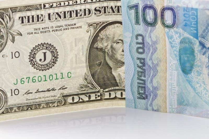 One dollar bill, one hundred rubles Sochi 2014 stock image