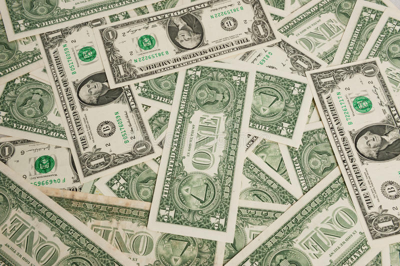 One dollar bills. Group of one dollar bills background royalty free stock images