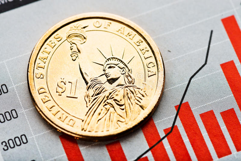 One dollar coin on fluctuating graph. Rate of the us dollar sha. Llow DOF stock images