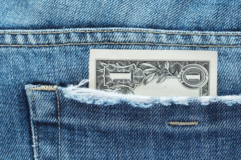 One dollar in a jeans pocket. One us dollar banknote in a jeans pocket stock photo