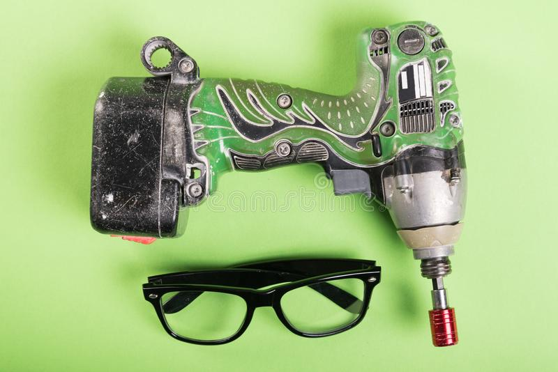 One drill and one pair of glasses royalty free stock photo