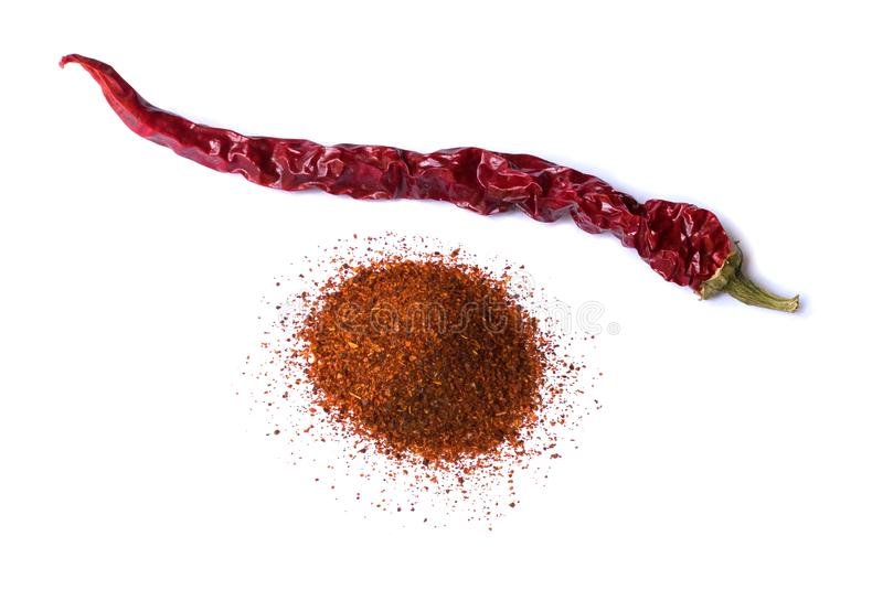 One dry red chili pepper on white background. Desiccated milled paprika. Stock images stock images