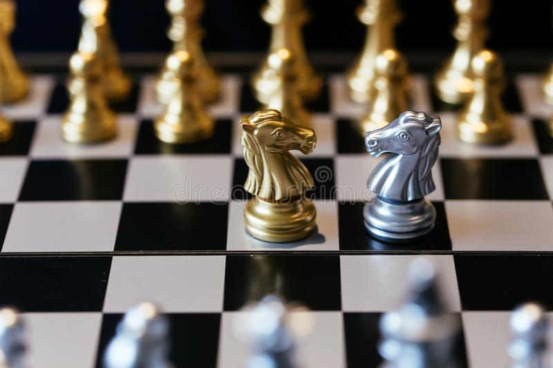 One on one duel between chess knights stock image