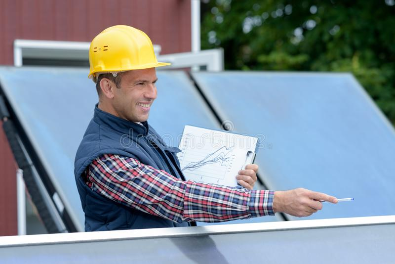 One electrician working on wrench tightening at solar mounting structure royalty free stock image