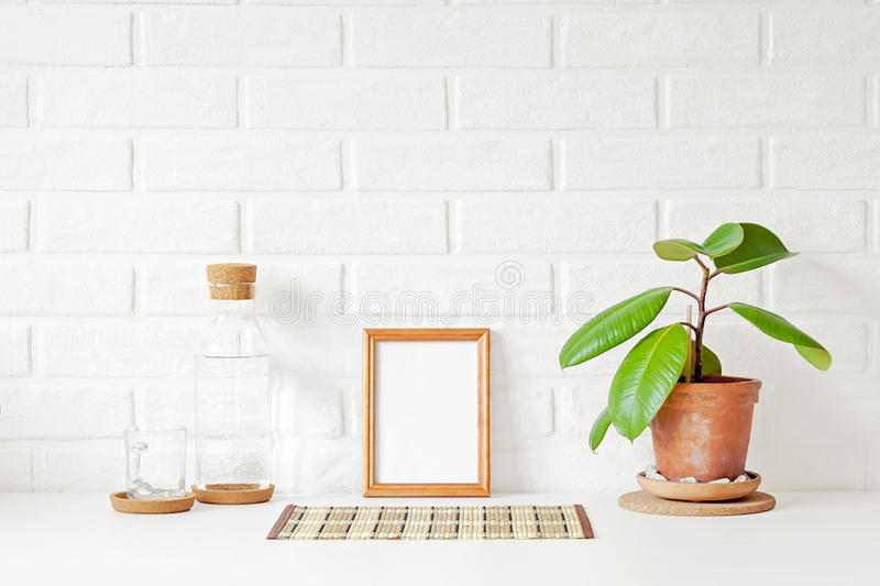 One empty wooden picture frame with white copy space on table stock image