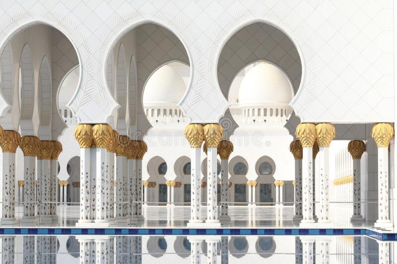 Sheikh Zayed Grand Mosque in Abu Dhabi. One of the entrances and walks and columns of Sheikh Zayed Grand Mosque in Abu Dhabi stock photo