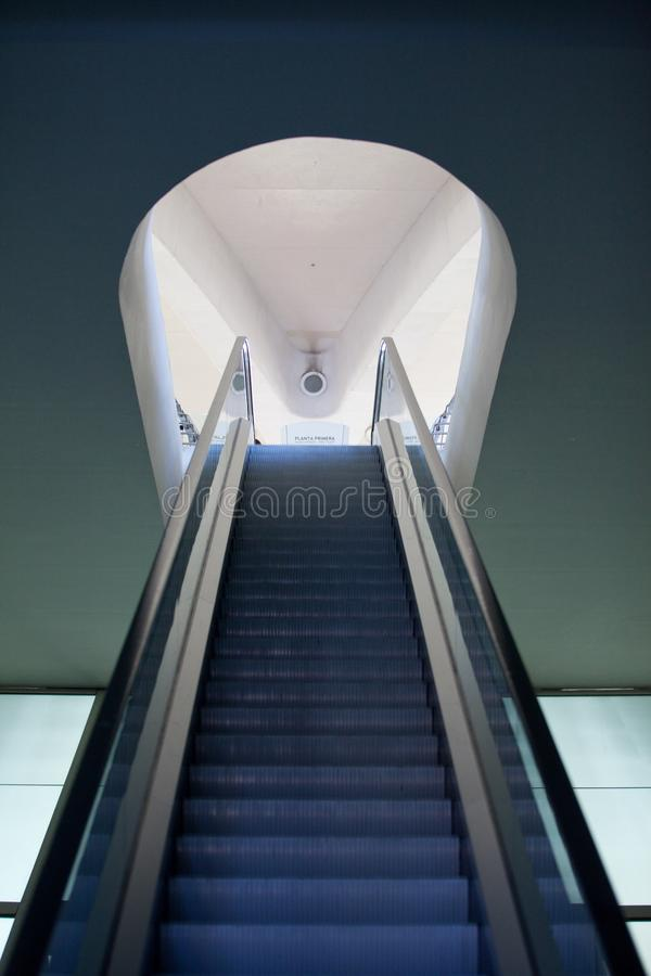 One escalator direction up only, concept. Indoors stock images