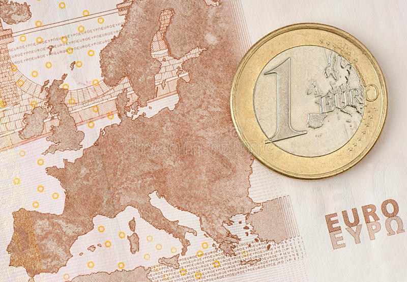 One Euro Coin on Euro Banknote. Showing Map of Europe royalty free stock photos