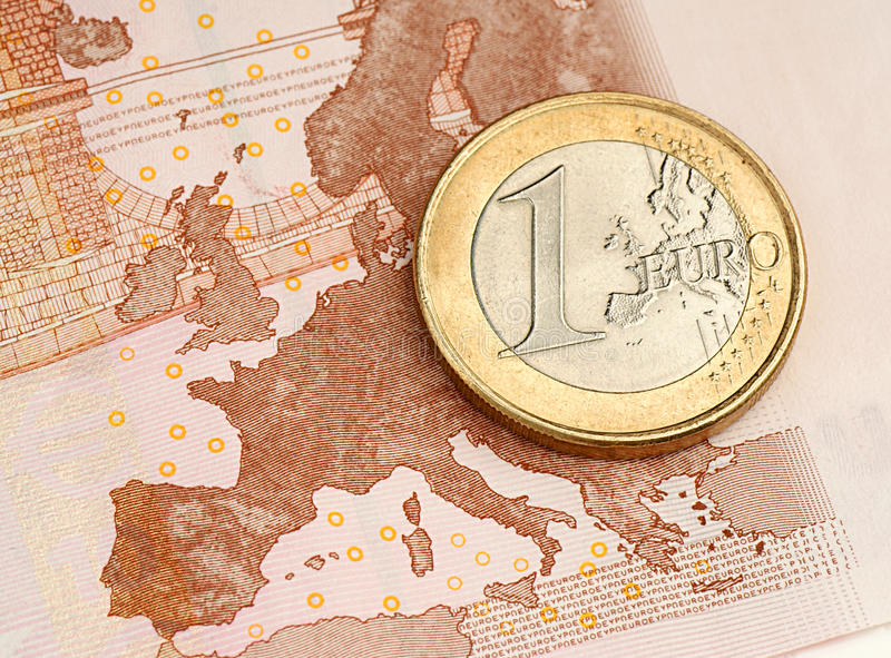 One Euro Coin on Euro Banknote. Showing Map of Europe royalty free stock image