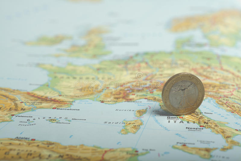 One euro coin on a European map (Italy)