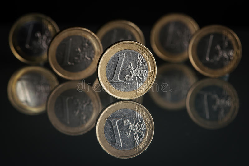 One euro coins. With reflection, black background stock photography