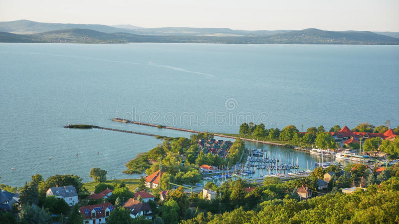 One of Europe`s largest lakes - Balaton. Popular tourist tours from many continental countries. Shallow fast warming lake royalty free stock photography