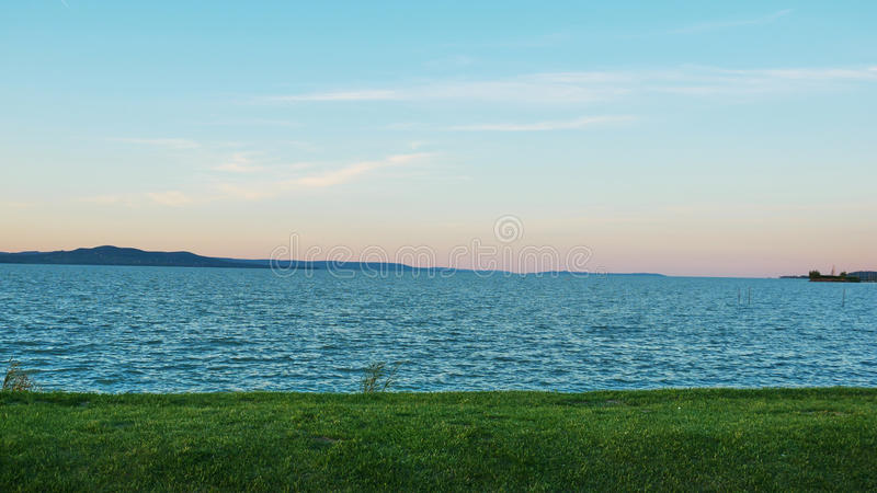 One of Europe`s largest lakes - Balaton. Popular tourist tours from many continental countries. Shallow fast warming lake stock photography