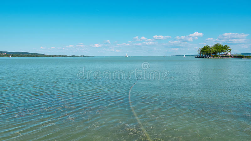 One of Europe`s largest lakes - Balaton. Popular tourist tours from many continental countries. Shallow fast warming lake royalty free stock image