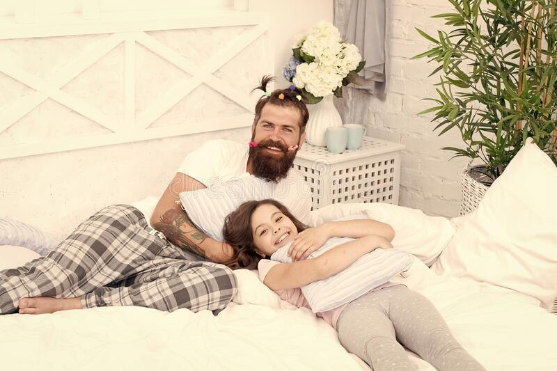 We are one. family bonding time. Relax sweetie. i love my daddy. happy morning together. funny pajama party. small girl royalty free stock photos