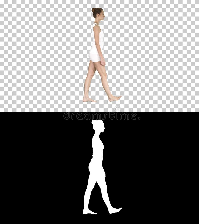 One female walking barefoot in white clothes, Alpha Channel. On Alpha Matte. Full length side view. One female walking barefoot in white clothes, Alpha Channel stock illustration