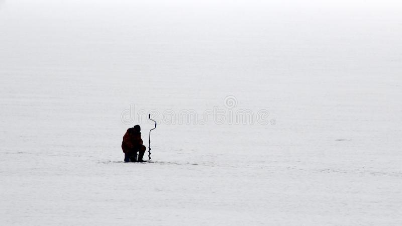 One fisherman goes fishing in the winter royalty free stock photo