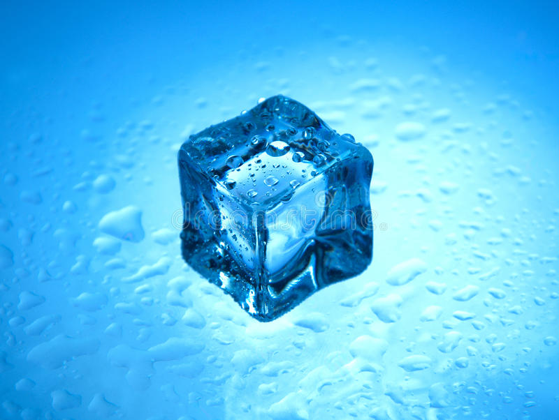 Download One Frozen Ice Cube With Clear Water Drops Stock Image