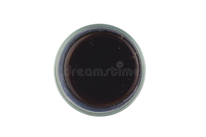 One full glass of aerated cola black color with bubbles isolated on white background. Top view stock photos