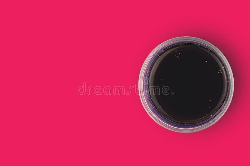 One full glass of aerated cola black color with bubbles on red table in cuisine. Copy space for your text. Top view. Rest concept stock photos