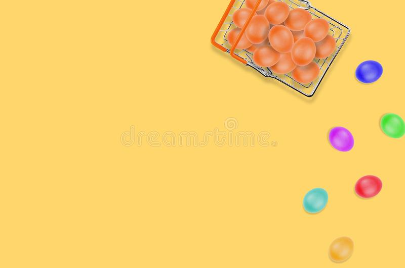 One full glossy metal market basket of fresh raw brown eggs on yellow table on kitchen. Top view. Business concept. Copy space. For your text stock images