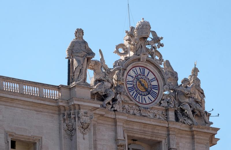 Giant clock on the St. Peter`s facade in Vatican royalty free stock images